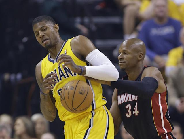 Indiana Pacers' Paul George, left, is defended by Miami Heat's Ray Allen during the first half of Game 2 of the NBA basketball Eastern Conference finals in Indianapolis, Tuesday, May 20, 2014. (AP Photo/Michael Conroy)