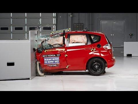 """<p>Fold the rear seats down in the 2013 Honda Fit, and the flat load floor gives 57 cubic feet of cargo space, 15 cubic feet more than the Ford Explorer of similar model year. We awarded it a 10Best trophy in 2007, again in 2008, and each year after until the third-generation Fit launched in 2015. It even earned a Top Safety Pick award from IIHS throughout those years, but with one major fault—its Poor rating for the driver-side small overlap crash test. Excessive dummy movement caused by the driver's seatbelt allowed the dummy's head to slide across and eventually off the airbag. An airbag with better coverage would've kept the dummy's head in place, and could've prevented it from striking the A-pillar, steering wheel, or dashboard. The Fit that followed received better safety ratings in IIHS crash tests. The problem of sliding between two airbags was solved, but excessive forward movement remained, causing the dummy's head to move so far forward it would make contact with the steering wheel through the airbag. </p><p><a href=""""https://www.youtube.com/watch?v=agCCJQIPLD0"""" rel=""""nofollow noopener"""" target=""""_blank"""" data-ylk=""""slk:See the original post on Youtube"""" class=""""link rapid-noclick-resp"""">See the original post on Youtube</a></p>"""