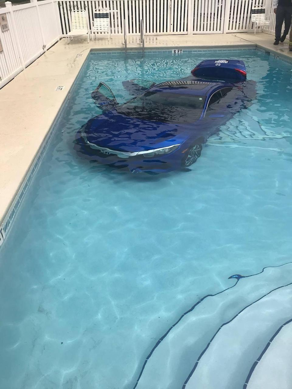 <em>No injuries – despite being in the car when it went into the pool, the woman's husband and daughter were fine</em>