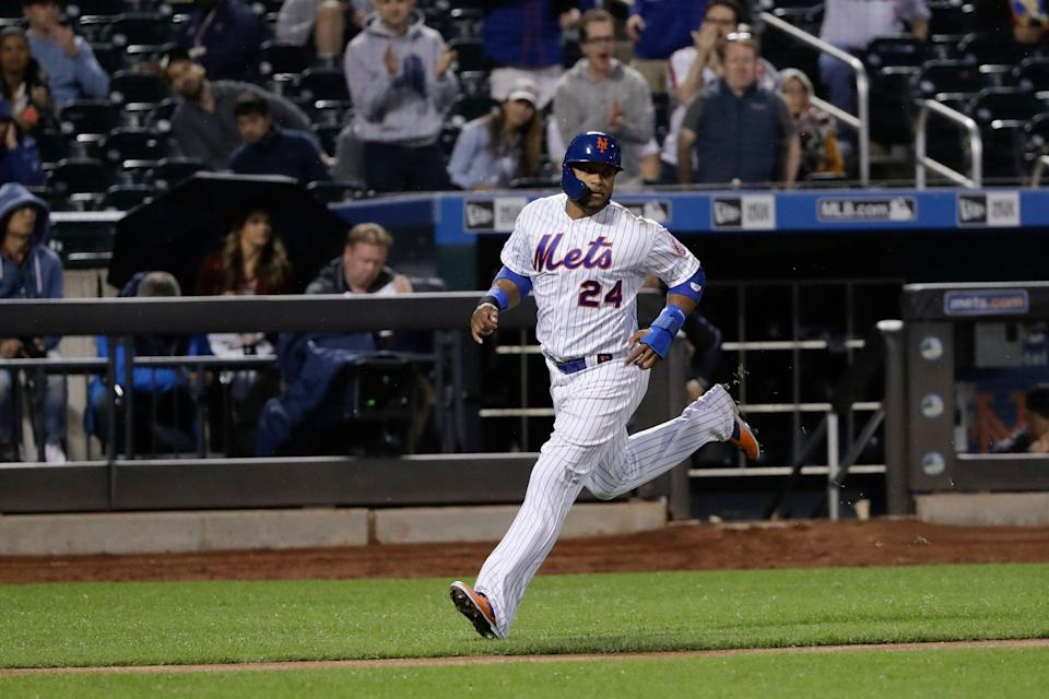 New York Mets' Robinson Cano (24) runs to home plate to score on a RBI single by Michael Conforto during the fourth inning of a baseball game against the Miami Marlins Saturday, May 11, 2019, in New York. (AP Photo/Frank Franklin II)