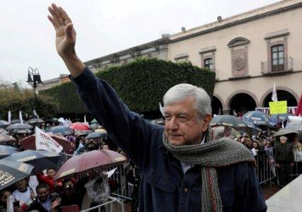 FILE PHOTO: Mexican presidential pre-candidate Andres Manuel Lopez Obrador of the National Regeneration Movement (MORENA) greets supporters during a pre-campaign rally in Queretaro, Mexico February 9, 2018. REUTERS/Henry Romero/File Photo