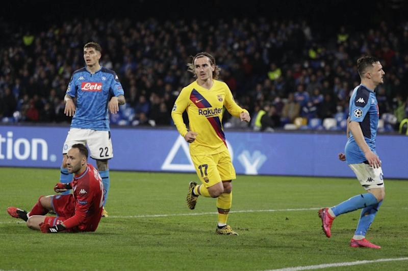 Barcelona's Antoine Griezmann, center, celebrates after scoring during the Champions League, Round of 16, first-leg soccer match between Napoli and Barcelona, at the San Paolo Stadium in Naples, Italy, Tuesday, Feb. 25, 2020. (AP Photo/Andrew Medichini)