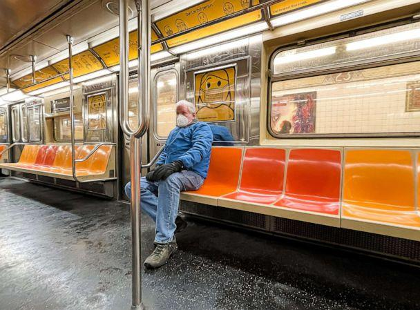 PHOTO: A person wears a face mask on an almost empty subway car on Dec. 18, 2020 in New York City. (Noam Galai/Getty Images)
