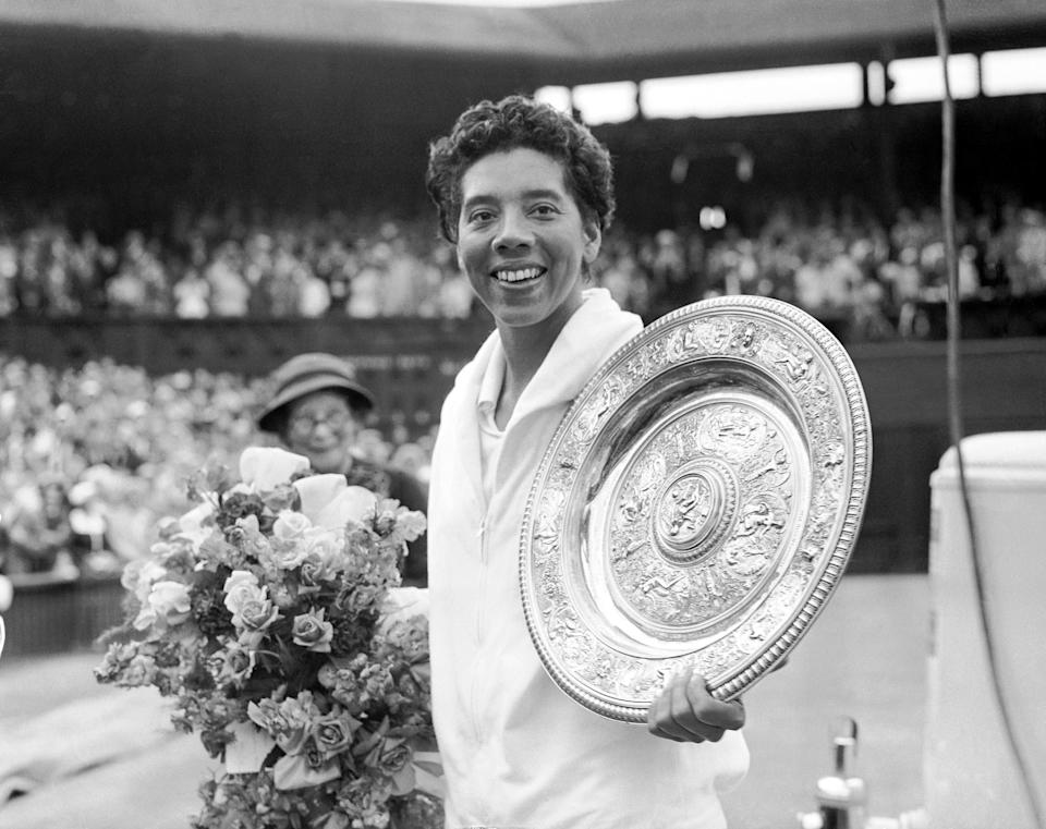 Althea Gibson shows off the Ladies' Singles trophy.