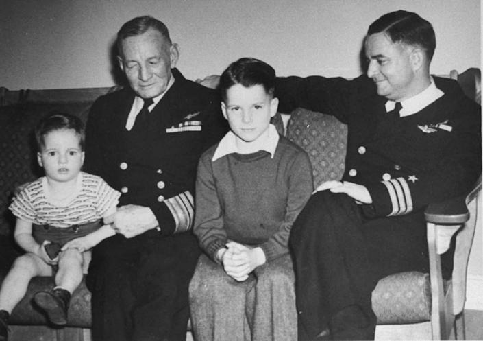 McCain as a young boy with his grandfather, Vice Admiral John S. McCain Sr., and father, Commander John S. McCain Jr., in a family photo from the 1940s.