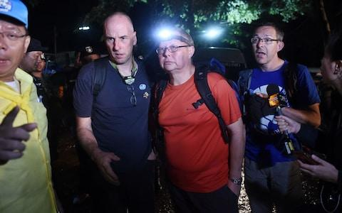 Three British cave-divers, Richard William Stanton (2nd-L), Robert Harper (3rd-L) and John Volanthen (R) arriving to help with efforts  - Credit: AFP