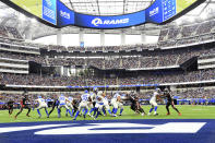 Los Angeles Rams quarterback Matthew Stafford (9) hands off to running back Sony Michel (25) during the first half of an NFL football game Sunday, Sept. 26, 2021, in Inglewood, Calif. (AP Photo/Kevork Djansezian)