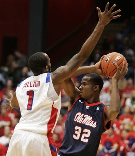 Dayton's Kevin Dillard (1) defends Mississippi's Jarvis Summers (32) during the first half of an NCAA college basketball game, Friday, Dec. 30, 2011, in Dayton, Ohio. (AP Photo/Skip Peterson)
