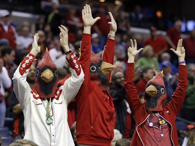 Louisville Cardinal fans cheer during the first half of Louisville's NCAA college basketball game against Connecticut in the finals of the American Athletic Conference men's tournament Saturday, March 15, 2014, in Memphis, Tenn. (AP Photo/Mark Humphrey)