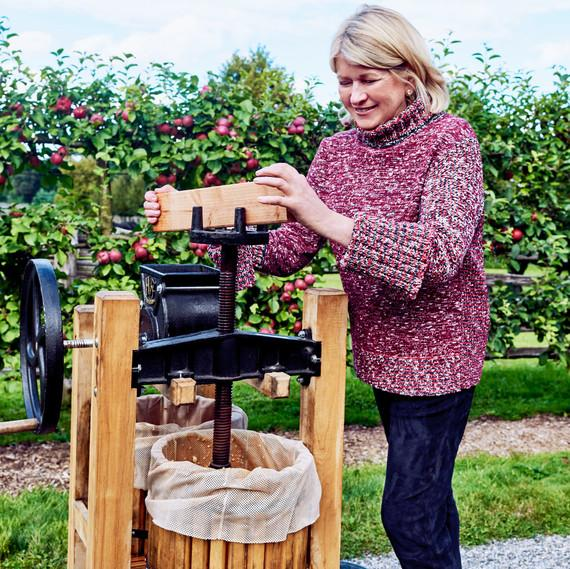 Martha turns her handcrafted American Harvester cider press from Happy Valley Ranch.   Paola + Murray