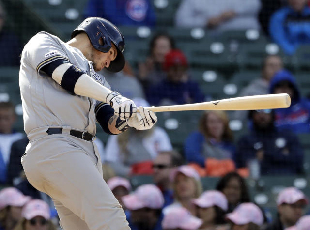 Milwaukee Brewers' Yasmani Grandal hits a one-run single against the Chicago Cubs during the ninth inning of a baseball game Friday, May 10, 2019, in Chicago. (AP Photo/Nam Y. Huh)