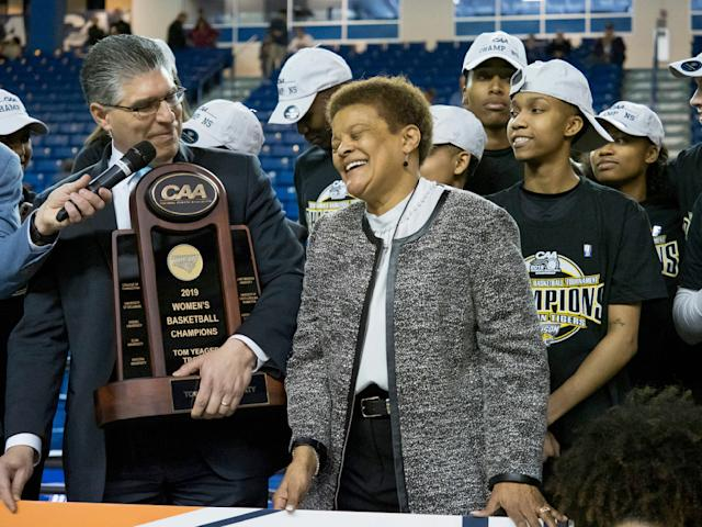 Towson head coach Diane Richardson is presented the trophy after their 53-49 win over Drexel in an NCAA college basketball game in the championship of the Colonial Athletic Association tournament, Saturday, March 16, 2019, in Newark, Del. (AP Photo/Suchat Pederson)