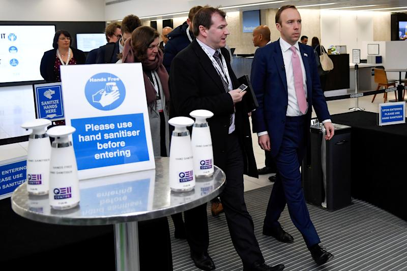 Britain's health minister Matt Hancock walks past a hand sanitising station as he leaves after talking about coronavirus at the annual conference of the British Chambers of Commerce in London, Britain, March 5, 2020. REUTERS/Toby Melville