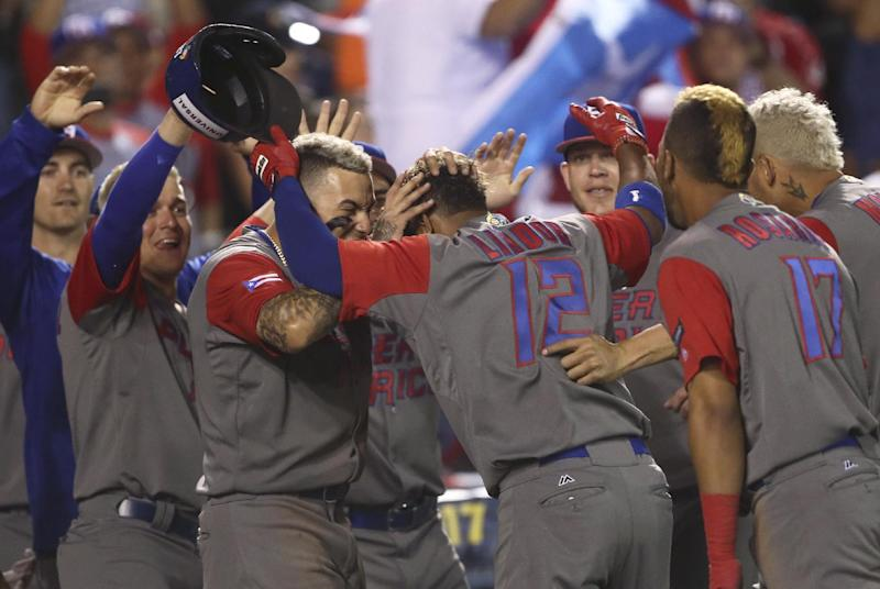 Puerto Rico's Francisco Lindor, celebrates with his teammates after a home run during a World Baseball Classic game against Mexico, in Guadalajara, Mexico, Saturday, March 11, 2017. (AP Photo/Luis Gutierrez)