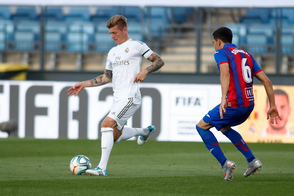 VALDEBEBAS, SPAIN - JUNE 14: Toni Kroos of Real Madrid and Sergio Alvarez of Eibar in action during the spanish league, LaLiga, football match played between Real Madrid and SD Eibar at Alfredo Di Stefano Stadium in the restart of the Primera Division tournament after to the coronavirus COVID19 pandemic, on June 14, 2020 in Valdebebas, Madrid, Spain. (Photo by Oscar J. Barroso / AFP7 / Europa Press Sports via Getty Images)