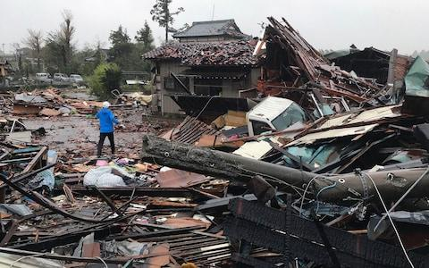 Damaged houses caused by Typhoon Hagibis are seen in Ichihara, Chiba  - Credit: Jiji Press/AFP
