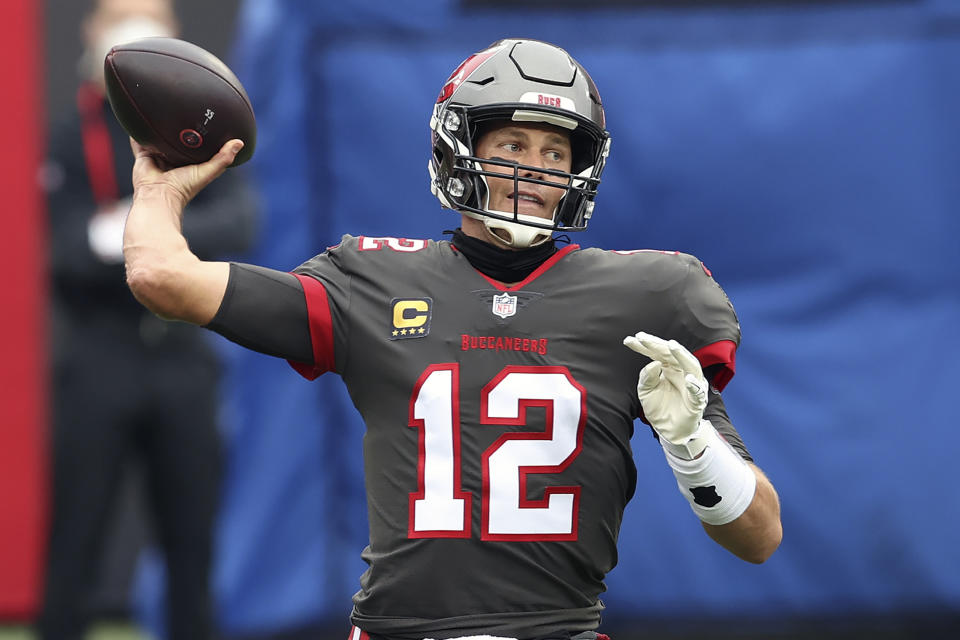 Tampa Bay Buccaneers quarterback Tom Brady (12) will be on prime time for wild-card weekend. (AP Photo/Mark LoMoglio)