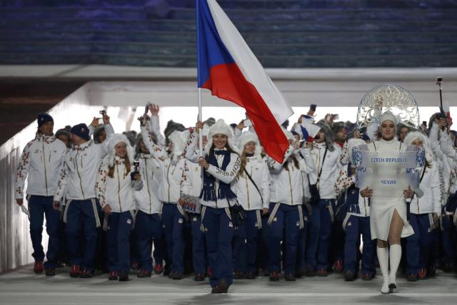 Flag-bearer Sarka Strachova of the Czech Republic leads her country's contingent during the opening ceremony of the 2014 Sochi Winter Olympics, February 7, 2014. REUTERS/Phil Noble (RUSSIA - Tags: OLYMPICS SPORT)