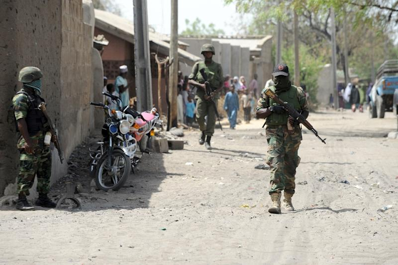 Soldiers patrol on a street in the remote northeastern Nigeria town of Baga, Borno State on April 30, 2013 (AFP Photo/Pius Utomi Ekpei)