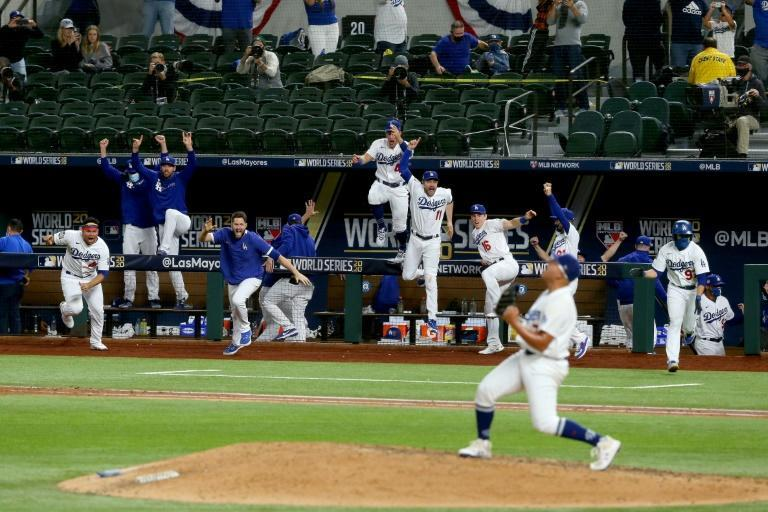 The Los Angeles Dodgers celebrate after Julio Urias strikes out Willy Adames of the Tampa Bay Rays for a World Series-clinching victory
