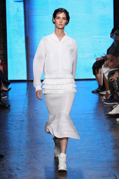 DKNY played with volume in the Spring/Summer 2015 collection, pairing flared skirts with sporty bomber jackets.