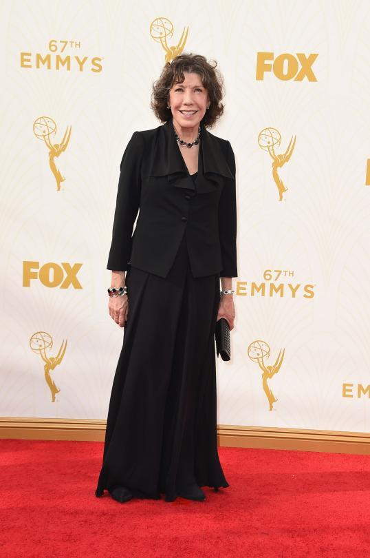 """<p>Lily Tomlin, nominated for her Netflix series """"Grace and Frankie,"""" probably should've chosen something younger and more boho, but the black dress with a blazer on top was still OK. </p>"""