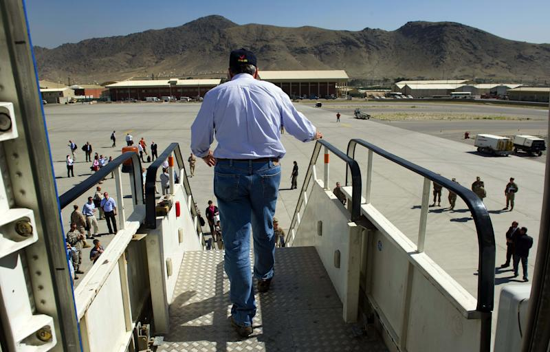 U.S. Defense Secretary Leon Panetta walks off his plane as he arrives at Kabul International Airport in Kabul, Afghanistan Thursday, June 7, 2012. Panetta arrived in Afghanistan on Thursday to take stock of progress in the war and discuss plans for the troop drawdown, even as violence spiked in the south. (AP Photo/Jim Watson, Pool)