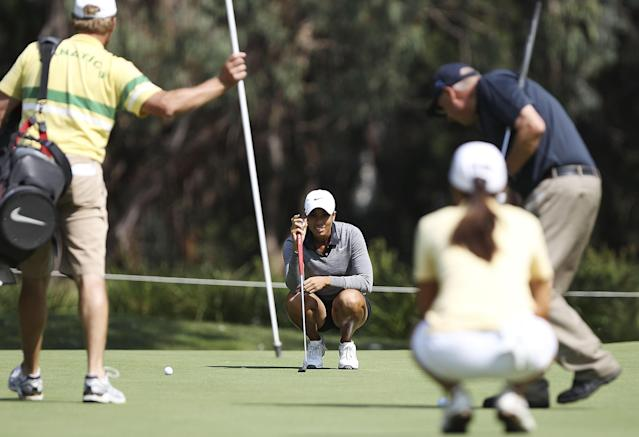 CANBERRA, AUSTRALIA - FEBRUARY 13: Cheyenne Woods lines up a putt during practice ahead of the ISPS Handa Australian Open at Royal Canberra Golf Club on February 13, 2013 in Canberra, Australia. (Photo by Stefan Postles/Getty Images)