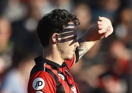 Bournemouth's Adam Smith shields his eyes from the sun