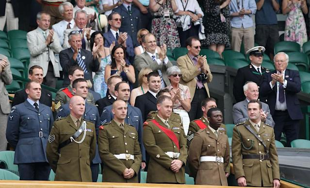 Members of the British Armed Forces receive a standing ovation on Centre Court where they were guests to mark Britain's Armed Forces Day at the All England Lawn Tennis Championships at Wimbledon, Saturday, June 26, 2010. (AP Photo/Anja Niedringhaus)