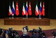 Iran's President Hassan Rouhani together with his counterparts Russia's Vladimir Putin and Turkey's Tayyip Erdogan attend a joint news conference following their meeting in Sochi, Russia November 22, 2017. Sputnik/Mikhail Klimentyev/Kremlin via REUTERS/Files