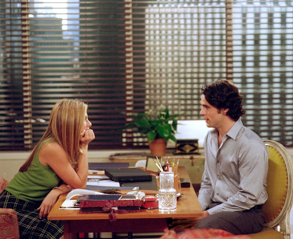 Actress Jennifer Aniston as Rachel Green and Eddie Cahill as Tag Jones act in a scene in NBC's comedy series 'Friends.' Episode: 'The One With Rachel's Assistant.' (Photo by Warner Bros. Television)