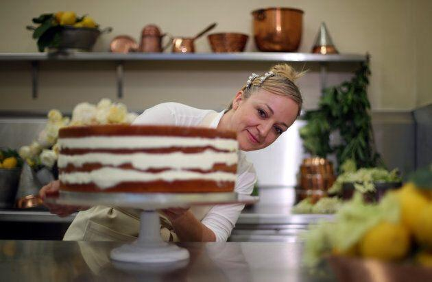 Claire Ptak puts the finishing touches on the wedding cake in the kitchens of Buckingham Palace in London, on May 17, 2018.