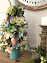 """<p>This floral topiary makes the perfect Easter centerpiece or hostess gift! Swap out the colors or theme to make one for another holiday. (How cute would it be to decorate one for the 4th of July using red, white, and blue flowers or vintage fireworks packaging?)</p><p><strong>Get the tutorial at <a href=""""http://southerncharmwreaths.com/designer-easter-egg-topiary/?utm_medium=social&utm_source=pinterest&utm_campaign=tailwind_smartloop&utm_content=smartloop&utm_term=16710940"""" rel=""""nofollow noopener"""" target=""""_blank"""" data-ylk=""""slk:Southern Charm Wreaths"""" class=""""link rapid-noclick-resp"""">Southern Charm Wreaths</a>.</strong></p><p><strong><a class=""""link rapid-noclick-resp"""" href=""""https://www.amazon.com/Luyue-Vintage-Artificial-Flowers-Decoration/dp/B01CVM5YKU?tag=syn-yahoo-20&ascsubtag=%5Bartid%7C10050.g.26498744%5Bsrc%7Cyahoo-us"""" rel=""""nofollow noopener"""" target=""""_blank"""" data-ylk=""""slk:SHOP SILK FLOWERS"""">SHOP SILK FLOWERS</a><br></strong></p>"""