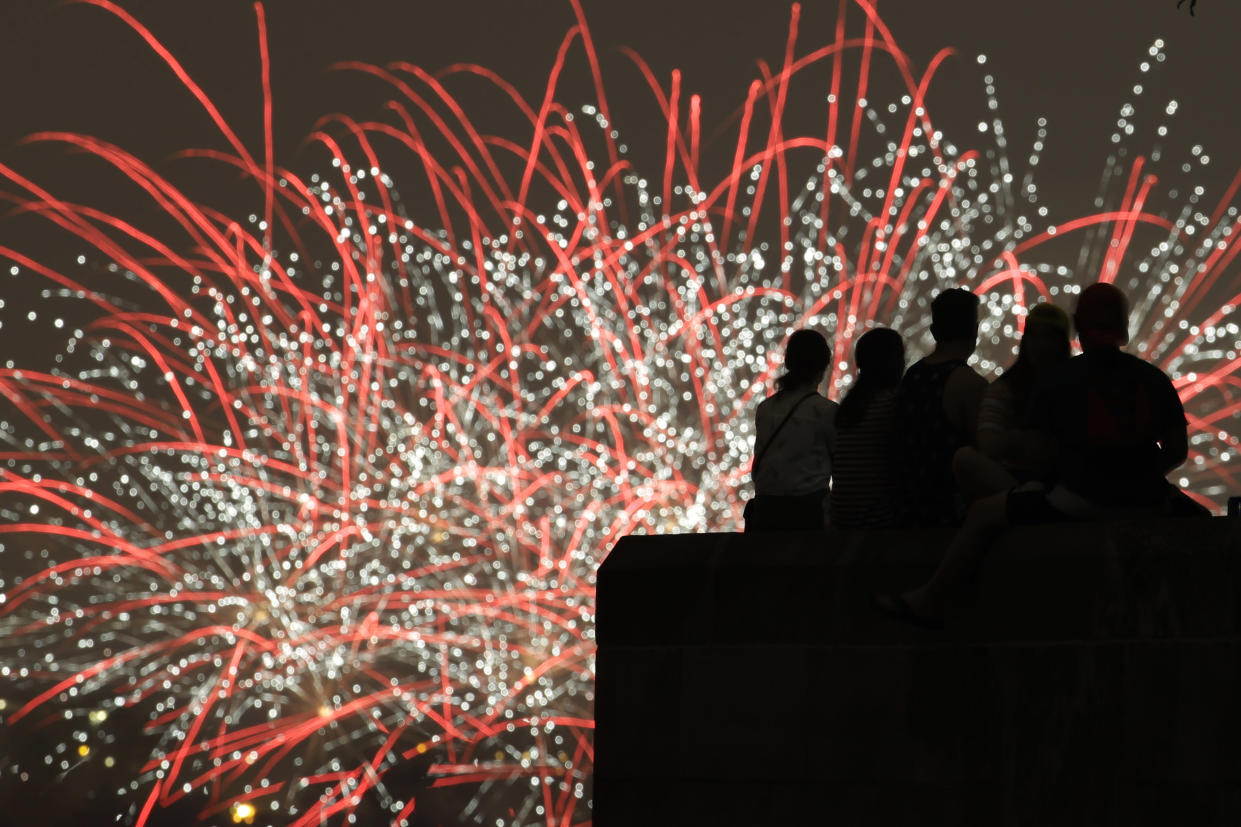 People watch Independence Day fireworks celebrations from the Liberty Memorial on July 4, 2019, in Kansas City, Mo. (Photo: Charlie Riedel/AP)