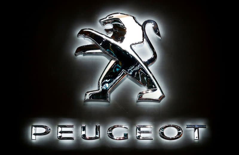 FILE PHOTO: The logo of French car manufacturer Peugeot is seen at Brussels Motor Show