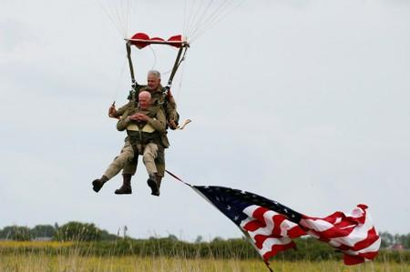 U.S. World War II paratrooper veteran Tom Rice, 97 years-old who served with the 101st Airbone, lands during a commemorative parachute jump over Carentan on the Normandy coast