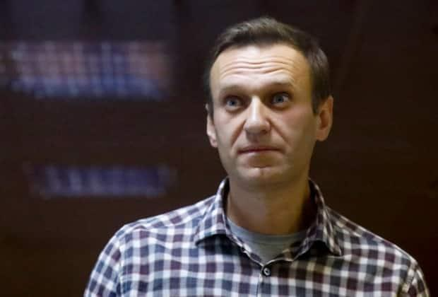 Navalny is shown in a prisoner's cage in the Babuskinsky District Court in Moscow on Feb. 20. He was jailed after returning to Russia in January from Germany, where he underwent medical treatment following an assassination attempt.