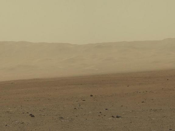 This color image from NASA's Curiosity rover shows part of the north wall of Gale Crater, the location on Mars where the rover landed on Aug. 5, 2012 PDT. The photo was snapped by Curiosity's Mastcam on Aug. 8.