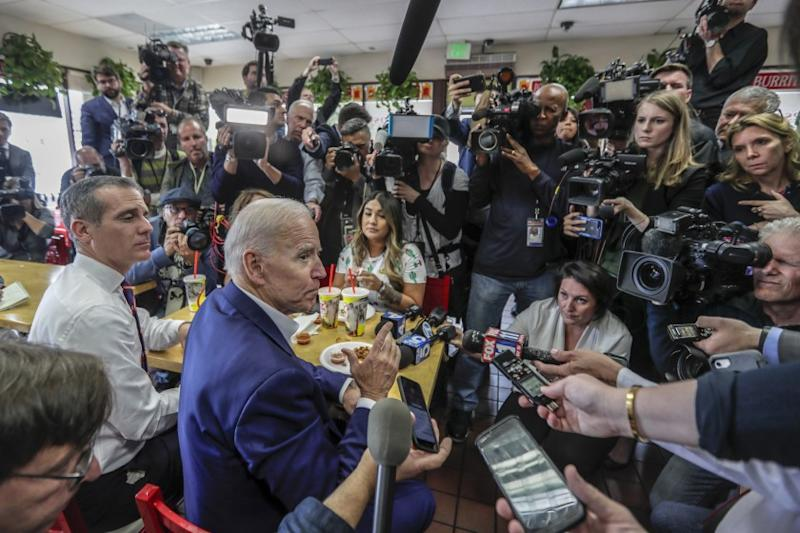 Presidential candidate Joe Biden and L.A. Mayor Eric Garcetti are swarmed by media during a visit to King Taco.