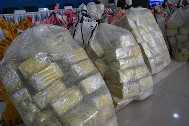 Bags of the drug crystal meth, also known as 'ice', were seized by Thai authorities in Bangkok, where street prices are plunging as a result of huge oversupply (AFP Photo/Aidan JONES)