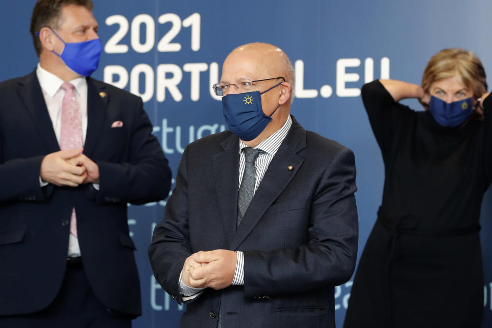 """Portuguese Foreign Minister Augusto Santos Silva waits to take part in a group photo with EU Commissioners in Lisbon, Friday, Jan. 15, 2021. Santos Silva considered """"without logic"""" the U.K.'s decision to ban travel from Portugal to ensure a new variant of COVID-19 found in Brazil doesn't derail the country's vaccination program. (AP Photo/Armando Franca)"""