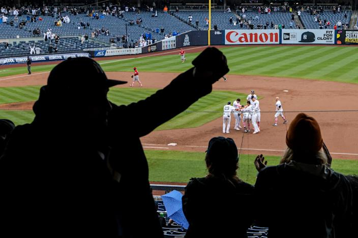 Yankees players celebrate after a win against the Nationals.
