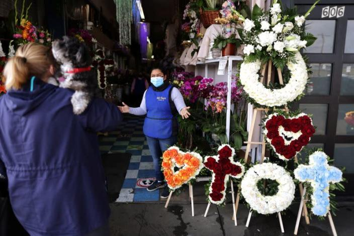 A woman shops at a florist ahead of Valentine's Day in Los Angeles