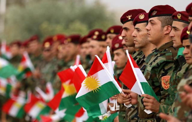 <p>Iraqi Kurdish peshmergas take part in a gathering on Sept. 20, 2017, to urge people to vote in the upcoming independence referendum in Arbil, the capital of the autonomous Kurdish region of northern Iraq. (Photo: Safin Hamed/AFP/Getty Images) </p>