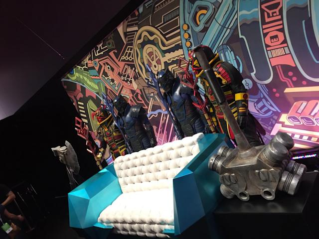 <p>A replica of the supersized sofa where Grandmaster takes in his gladiatorial games. Hulk's battleaxe and warhammer bookend the sofa, while Sakaarian guards stand at attention. (Photo: Marcus Errico/Yahoo Movies) </p>