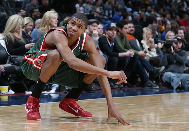 Milwaukee Bucks forward Giannis Antetokounmpo, of Greece, reacts after hurting his leg against the Denver Nuggets late in the fourth quarter of the Nuggets' 110-100 victory in an NBA basketball game in Denver on Wednesday, Feb. 5, 2014. (AP Photo/David Zalubowski)