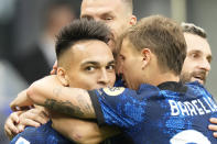 Inter Milan's Lautaro Martinez celebrates with teammates after scoring his side's first goal during an Italian Serie A soccer match between Inter Milan and Atalanta, at the San Siro stadium in Milan, Italy, Saturday, Sept. 25, 2021. (AP Photo/Luca Bruno)