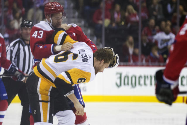 Washington Capitals right wing Tom Wilson (43) fights with Pittsburgh Penguins defenseman Jamie Oleksiak (6) in the first period of an NHL hockey game, Wednesday, Dec. 19, 2018, in Washington. (AP Photo/Alex Brandon)