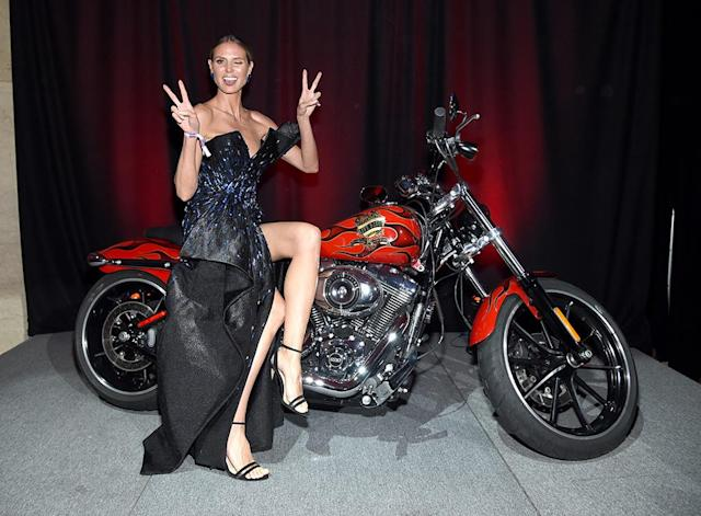 <p>The <em>America's Got Talent</em> judge always seems to find the perfect accessory to pose with — like this hot motorcycle at the amfAR Gala on Wednesday. (Photo: Dimitrios Kambouris/amfAR/Getty Images) </p>